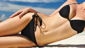 woman on the beach after liposuction